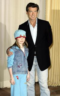 Sophie Vavasseur and Pierce Brosnan at the premiere party of