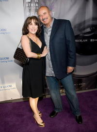 Robin McGraw and Phil McGraw at the book party for