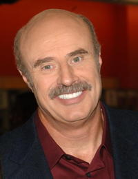 Phil McGraw at the signing of his wife Robin McGraw's new book