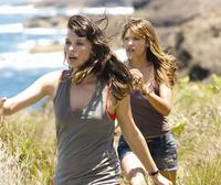 Milla Jovovich as Cydney and Kiele Sanchez as Gina in
