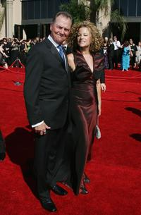 Gregory Itzin and guest at the 58th Annual Primetime Emmy Awards.