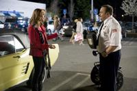 Jayma Mays as Amy and Kevin James as Paul Blart in