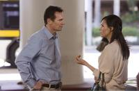 Liam Neeson as Bryan Mills and Famke Janssen as Lenore in