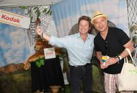 Billy Bush and Howie Mandel at the Kodak Photo Sharing booth during the 21st Annual
