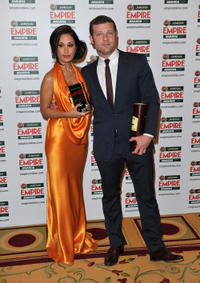 Preeya Kalidas and presenter Dermot O'Leary at the Best Comedy award for