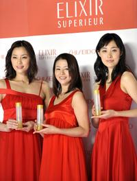 Asaka Seto, Kyoko Koizumi and Kazue Fukiishi at the display of the skin care and anti-aging product brand