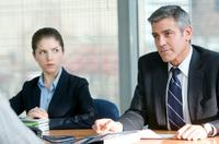 Anna Kendrick as Natalie Keener and George Clooney as Ryan Bingham in