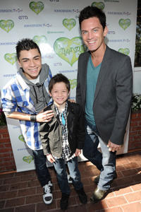 Adam Irigoyen, Davis Cleveland and Brandon Johnson at the Greenzy's First Annual Family Earth Day Celebration in California.