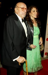 Ahmet Ertegun and Guest at the Warner Music Group Post-Grammy party.