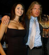 Kitana Baker and Triple H at the media conference announcing the all-star lineup of