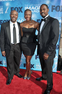 Writer Phononzell Williams, Aisha Hinds and writer Mike Flynn at the 42nd NAACP Image Awards in California.