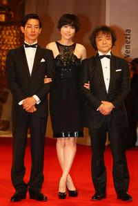 Ryo Kase, Rinko Kikuchi and director Mamoru Oshii at the premiere of