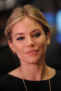 Sienna Miller at the New York Stock Exchange opening bell.
