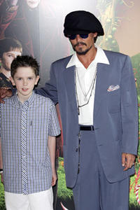 Freddie Highmore and actor Johnny Depp at the UK Premiere of