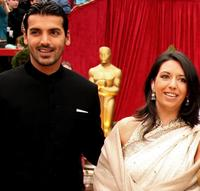 John Abraham and Guest at the 79th Annual Academy Awards.
