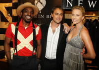 Andre Benjamin, Stuart Townsend and Charlize Theron at the Mercedes-Benz Fashion Week Spring 2009.