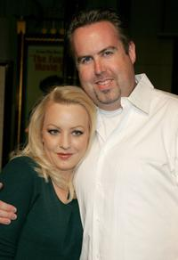 Wendi McLendon-Covey and Guest at the premiere of