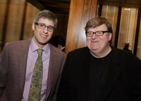 Mo Rocca and Michael Moore at the luncheon celebrating Moore's documentary