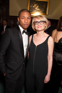 Pharrell Williams and Evelina Khromchenko at the Dolce & Gabbana and Martini dinner in Russia.