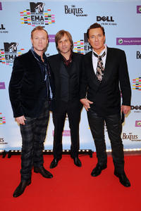 Gary Kemp, Steve Norman and Guest at the 2009 MTV Europe Music Awards in Berlin.