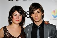 Katie Boland and Devon Bostick at the premiere of