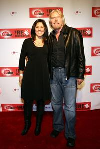 Carrisa Phelps and Richard Branson at the Virgin Mobile USA RE*Generation art auction.