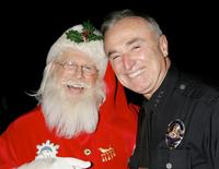 William J. Bratton with Santa Claus at the 2005 Hollywood Christmas Parade.
