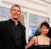 Daniel Travis and Laura Lau at the premiere of
