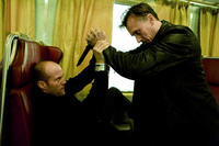Jason Statham as Frank Martin and Robert Knepper as Johnson in