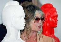 Brigitte Bardot next to the Bust of Marianne the symbol of the French Republic.