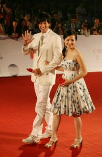 Peter Ho and Dong Jie at the opening ceremony of the 11th Shanghai International Film Festival.