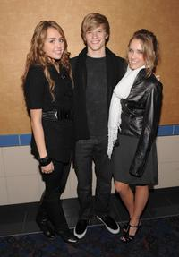 Miley Cyrus, Lucas Till and Emily Osment at the screening of