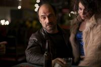 Elias Koteas as Chuck Dooney and Tatiana Maslany as Olga in