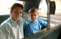 Harry Eden and Barney Clark at the ride in a taxi to Times Square in New York City.