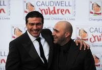 Tamer Hassan and Guest at the Caudwell Children
