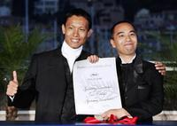 Sakda Kaewbuadee and Apichatpong Weerasethakul at the closing ceremony of 57th Cannes Film Festival.