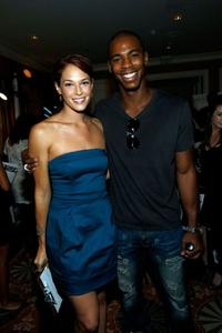 Amanda Righetti and Mehcad Brooks at the 61st Primetime Emmy Awards.