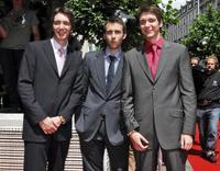 Oliver Phelps, Matthew Lewis and James Phelps at the release of