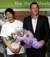 Lance Armstrong with the child cancer patient at the charity event.