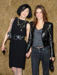 Maggie Cheung and Joana Preiss at the Chanel Pret a Porter show during the Paris Womenswear Fashion Week Spring/Summer 2010.