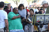Director Lance Rivera with Queen Latifah on the set of