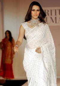 Neha Dhupia at the Winter-Spring 2005-06 collection of Indian designer Ritu Kumar during the fashion show.