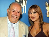Robin Leach and his girlfriend Laura Diane at the premiere of