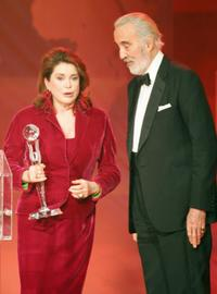 Christopher Lee and Catherine Deneuve at the ceremony of the Women's World Awards 2005.