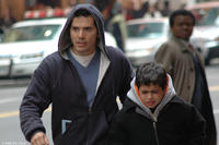 John Leguizamo as Frank Diaz and David Castro as Justin Diaz in