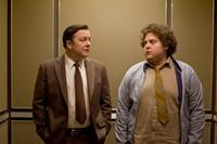 Ricky Gervais as Mark Bellison and Jonah Hill as Frank in