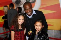 Madison Pettis, Phill Lewis and guest at the premiere of