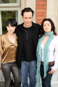 Rinko Kikuchi, John Cusack and Gong Li at the photocall of