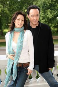 Gong Li and John Cusack at the promotion of
