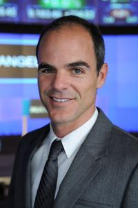 Michael Kelly at the ringing of NASDAQ stock market closing bell.
